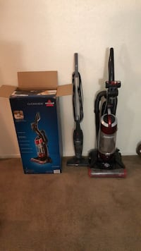 Two black and gray upright vacuum cleaners North Las Vegas, 89032