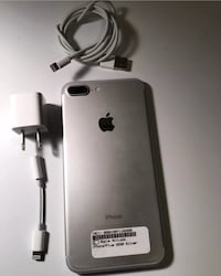 silver iPhone 7 plus with charger 102 mi