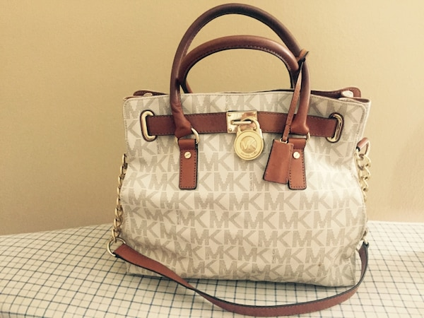 59beafd575c8 Used gray, white, brown monogram Michael Kors 2-way tote bag for sale in  Metairie