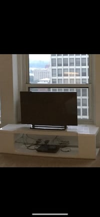 black flat screen TV with white wooden TV stand Schererville, 46375
