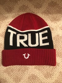 red and black True Religion knit cap
