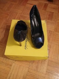 pair of black Candy Couture peep-toe heeled leather shoes with yellow box Toronto, M3N 2T8