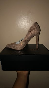 pair of gray glittered platform stilettos 219 mi