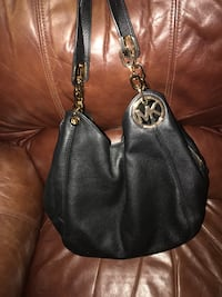black Michael Kors leather hobo bag