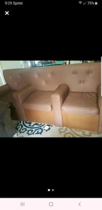 One of a kind sofa w/built in storage space
