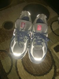 pair of gray-and-black Nike running shoes 45 km