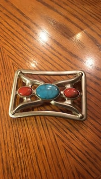 gray, blue and red gem belt buckle