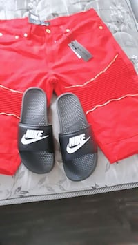 pair of black-and-red Nike slide sandals Columbia, 29203
