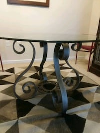 Solid iron base glass top table.  Clarksburg, 20871