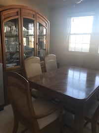 Table, 6 chairs and china cabinet. couple chairs have some scratches