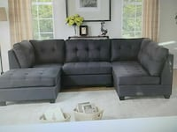 gray tufted sectional couch with ottoman