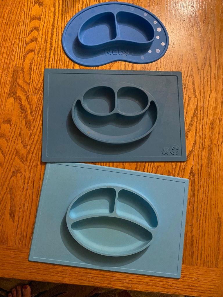 Photo $45-firm on price-3 silicone Placemats for baby and toddlers stick to the table so baby can't pull it off-love these but my lil guy has graduated to big boy plates. These are completely dishwasher safe which is great way to sanitize them.