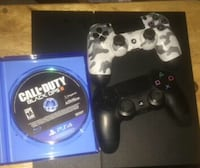Sony ps4 console with two controllers and game cases