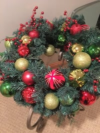 multicolored christmas baubles green wreath