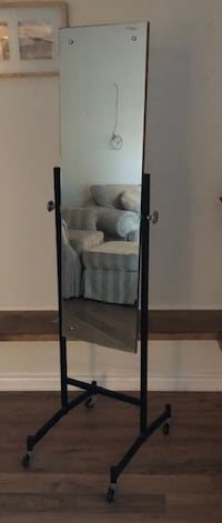 Excellent Mirror can be tilted and on wheels. Overall height 68 inches and width 16 inches Brampton
