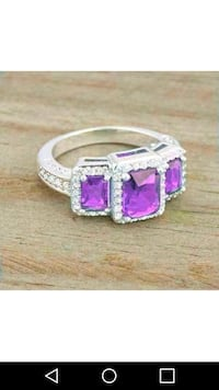 Stainless steel amethyst ring.