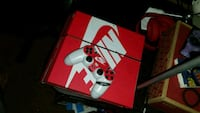 red and white Sony PS4 console