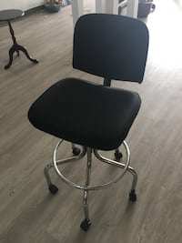 Tall rolling office chair