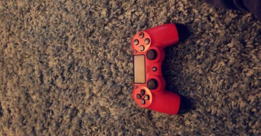 red and black Sony PS4 controller 9b46add2-221c-481d-beca-00e338529a3b