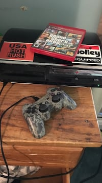 Sony PS3 console and controller with game case