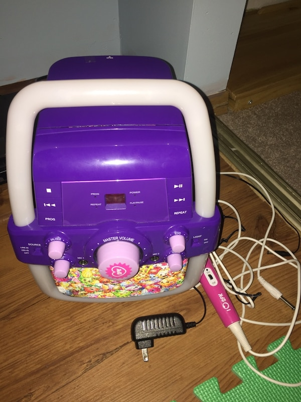 purple and white Karaoke machine with microphone