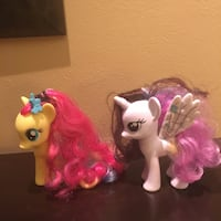 two yellow and white my little pony toys