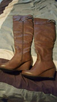 pair of brown leather knee high boots Calgary, T2Z 3Y5