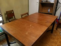 rectangular brown wooden table with four chairs di Ottawa, K2H 8J8