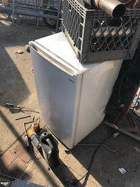 It's a working mini fridge it's about 3.5 ft tall it's has a small spot for freezing  Pasadena, 91103