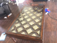 brown wooden framed glass top coffee table Windermere, 34786