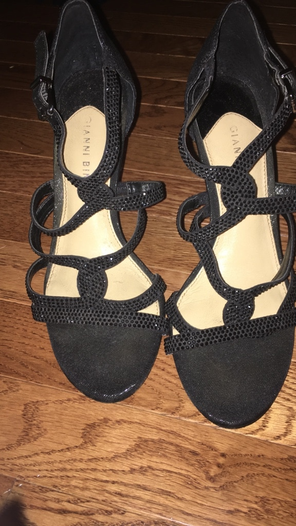 Pair of black Strappy heels, worn one, bought for $80. In great condition