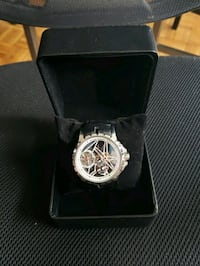 round silver chronograph watch with black leather strap Toronto