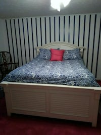 white wooden bed frame with blue floral bedspread Louisville, 40220