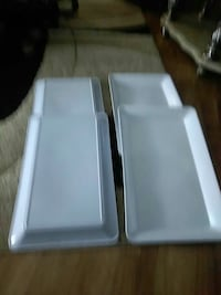 four rectangular white ceramic trays