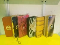 four assorted color leather wallets Clayton, 19938