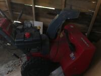 Red and black snow blower