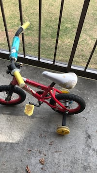 toddler's red and yellow bicycle with training wheels Annandale, 22003