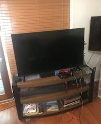 flat screen television with brown wooden TV stand Annandale, 22003