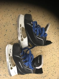 pair of black-and-white Bauer ice skates Mississauga, L5R 3Y7