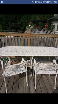 white metal framed patio table with chairs