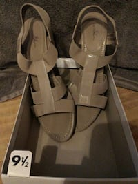 pair of brown leather open-toe heeled sandals with box