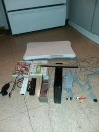 $50 OBO- Wii with 2 games,fit board, 2controllers , stand, all cords North Las Vegas, 89030