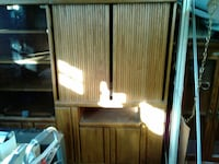 Oak tv cabinet with drawers and sliding doors