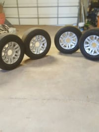 four silver 5-spoke vehicle wheel with tires set