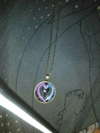round gold frame with two purple and blue dragon h