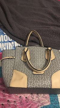 gray and brown monogrammed Gucci leather tote bag