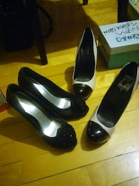 two pairs black and white leather shoes