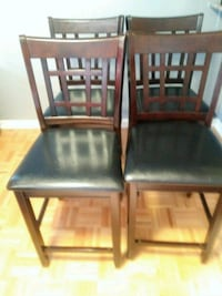 two black wooden framed black leather padded chairs Toronto, M6K 2E2