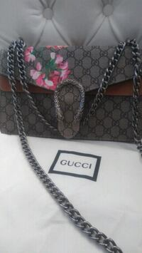 gray and black Gucci leather tote bag