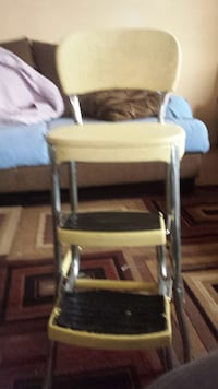 brown high chair with ladder